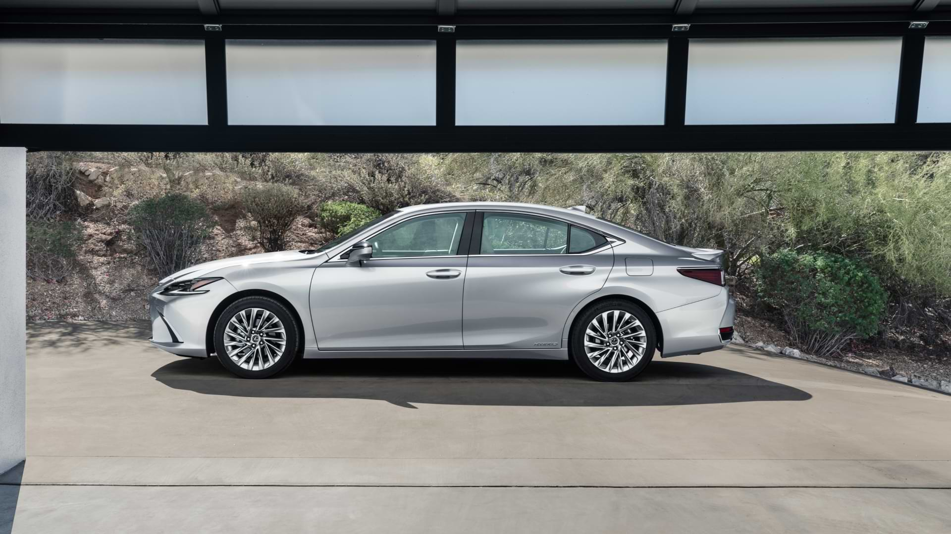 Side on view of a 2021 Lexus ES, parked outside a garage.